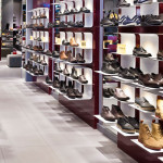 Picture with occupied shoe shelfs with integrated f-sign ONELED lighting solutions in inspiration corner of Lighting-Inspiration.com