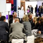 Image of living discussions at showfloor of PLDC event
